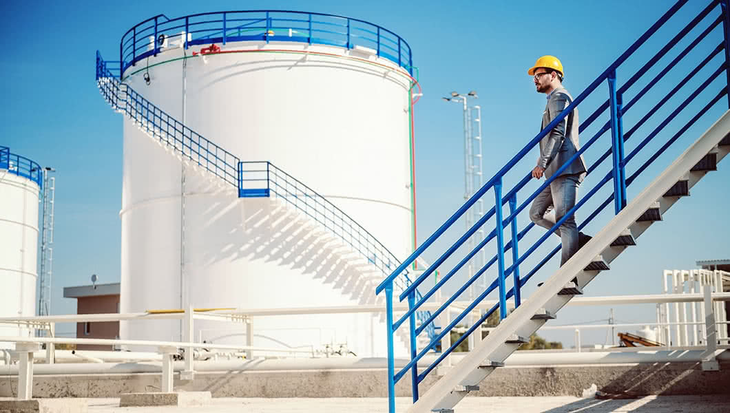 Poly Processing - Photo of worker in front of chemical tank